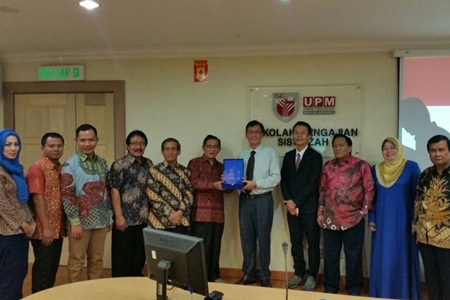Dr. H.Ahmad Badawi and Prof. Bujang exchanging gifts