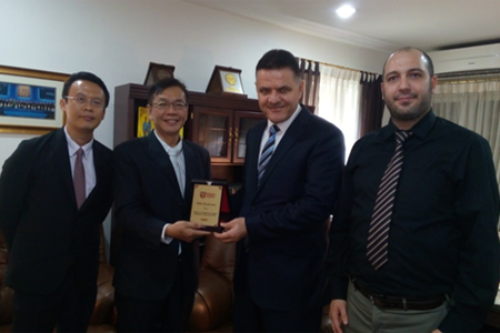 Prof. Bujang (second from left) and Dr. Maen Masadeh (third from left), the Charge D' Affairs of the Embassy of the Hashemite Kingdom of Jordan exchanging gifts